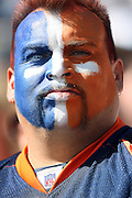 SHOT 9/17/2006 - A Denver Broncos fan proudly displays the team's colors during a game against the Kansas City Chiefs Sunday September 17, 2006 at Invesco Field at Mile High in Denver, Co. The Denver Broncos are a professional American football team based in Denver, Colorado. They are currently a member of the American Football Conference (AFC) Western Division in the National Football League (NFL). The Broncos began play in 1960 as a charter member of the American Football League and joined the NFL as part of the AFL-NFL Merger. The Broncos were a small-market team that met with little success in their early years, but have since become one of the elite franchises of the league after having advanced to the Super Bowl six times. In their first four Super Bowl appearances, they suffered successively lopsided defeats, achieving near-legendary status before winning back-to-back Super Bowl championships in 1997 and 1998 under quarterback John Elway, running back Terrell Davis and coach Mike Shanahan..(MARC PISCOTTY/ © 2006)