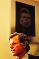 Ted Kennedy in his Senate office, below a portrait of his brother, John Fitzgerald Kennedy