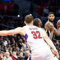 04 December 2016: Indiana Pacers forward Paul George (13) looks to pass the ball over LA Clippers forward Luc Mbah a Moute (12) and LA Clippers forward Blake Griffin (32) during the Indiana Pacers 111-102 victory over the LA Clippers, at the Staples Center, Los Angeles, California, USA.