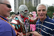 Florida Governor Charlie Crist meets an interesting character - even by Florida standards - at the 2007 Gasparilla Parade in Tampa, Florida.  More than a quarter of a million people turned out for the parade.