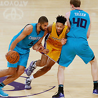 28 February 2017: Charlotte Hornets guard Nicolas Batum (5) drives past Los Angeles Lakers forward Brandon Ingram (14) on a screen set by Charlotte Hornets center Cody Zeller (40) during the Charlotte Hornets 109-104 victory over the LA Lakers, at the Staples Center, Los Angeles, California, USA.