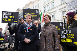 © Licensed to London News Pictures. 21/02/2018. London, UK. Richard Ratcliffe (L), husband of Nazanin Zaghari-Ratcliffe, joins protesters outside the Iranian Embassy in London, ahead of an expected visit by a senior Iranian minister. British-Iranian Nazanin Zaghari-Ratcliffe has been detained in Iran since April 2016. Photo credit: Rob Pinney/LNP
