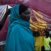 Since 1983 and the imposition of the Sharia law, the traditions of the Nuba have dramatically changed. As indigenous, they were not used to wearing clothes, or speaking any other language than their colloquial ones. Nowadays, the younger generation only speak Arabic, and they all cover themselves as if they were Muslims. <br /> The tradition for a bride of walking under a veil comes from arabist Northern Sudan.