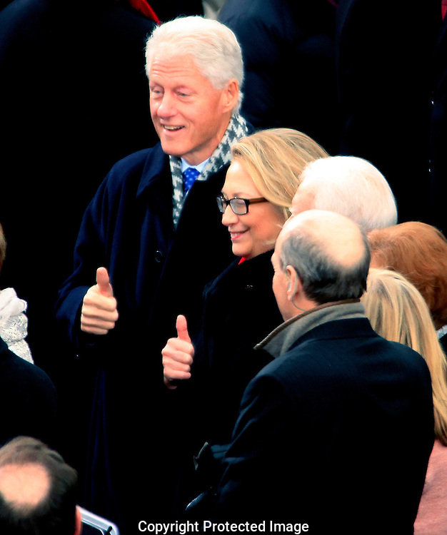 """Former President Bill Clinton and Secretary of State Hillary Rodham Clinton give a """"thumbs up"""" at the swearing in ceremony for President Barack Obama at the US Capitol on January 21, 2013.  Photo by Dennis Brack"""