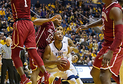 Jan 18, 2017; Morgantown, WV, USA; West Virginia Mountaineers guard Jevon Carter (2) dribbles in traffic during overtime against the Oklahoma Sooners at WVU Coliseum. Mandatory Credit: Ben Queen-USA TODAY Sports