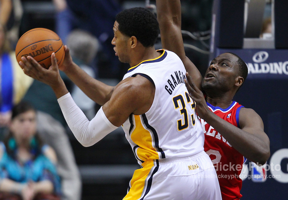 March 14, 2012; Indianapolis, IN, USA; Indiana Pacers small forward Danny Granger (33) shoots the ball against Philadelphia 76ers power forward Elton Brand (42) at Bankers Life Fieldhouse. Indiana defeated Philadelphia 111-94. Mandatory credit: Michael Hickey-US PRESSWIRE