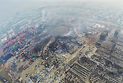 TIANJIN, CHINA - AUGUST 15: (CHINA OUT) <br /> <br /> Aerial View Of Blast Site Three Days After Tianjin's Warehouse Explosion<br /> <br /> (Image taken with GoPro) Aerial view of dangerous goods blast site three days after massive explosive on late Wednesday in Binhai New Area on August 15, 2015 in Tianjin, China. Over 700 injured and evacuated people have been settled at emergency shelter in Binhai New Area after Wednesday explosion of a warehouse in Tianjin. The death toll rose to 85 Friday evening, and 21 of whom were firemen, local authorities said.<br /> ©Exclusivepix Media