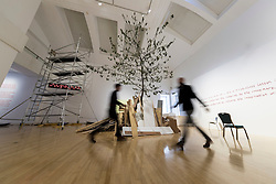 A huge cherry tree fills the interior of an Edinburgh gallery as part of an anarchic new show. <br /> <br /> Standing more than eight metres tall and scraping the ceiling of the University&rsquo;s Talbot Rice Gallery, the tree is the centrepiece of acts of display, a new exhibition from Glasgow-based artist Rob Kennedy.<br /> <br /> The tree was sourced from Edinburgh&rsquo;s Inverleith Park. Over the course of the show the leaves will fall and litter the indoor space. <br /> <br /> The work is a response to two paintings owned by the University, one by David Teniers called Peasants Playing Bowls and a second anonymous copy which is missing a tree and a male figure from the original.
