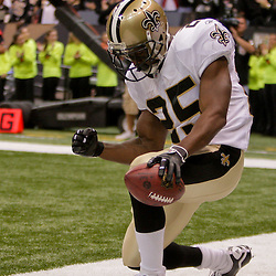 2009 October 18: New Orleans Saints running back Reggie Bush (25) celebrates after scoring a touchdown during the second quarter against the New York Giants at the Louisiana Superdome in New Orleans, Louisiana.