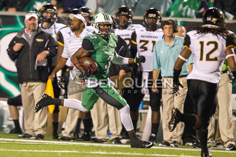 Oct 9, 2015; Huntington, WV, USA; Marshall Thundering Herd wide receiver Davonte Allen runs after a catch during the second quarter against the Southern Miss Golden Eagles at Joan C. Edwards Stadium. Mandatory Credit: Ben Queen-USA TODAY Sports