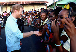 Prince Harry meets members of the public whilst attending a St Lucian street festival in Soufriere on the island of St Lucia during the second leg of his Caribbean tour.