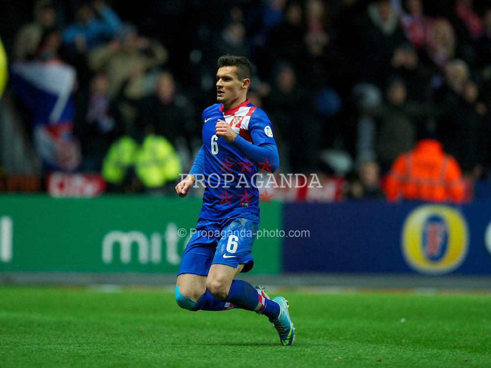 SWANSEA, WALES - Tuesday, March 26, 2013: Croatia's Dejan Lovren celebrates scoring the first goal against Wales during the 2014 FIFA World Cup Brazil Qualifying Group A match at the Liberty Stadium. (Pic by David Rawcliffe/Propaganda)