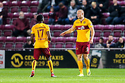 Curtis Main (#9) of Motherwell celebrates Motherwell's first goal (0-1) with Gael Bigirimana (#17) of Motherwell during the Betfred Cup match between Heart of Midlothian and Motherwell at Tynecastle Stadium, Gorgie, Scotland on 26 September 2018.
