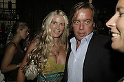 Jo Wild and David Bagley, Cartier Polo Players Party, The Collection, 264 Brompton Road, London, SW3, 25 July 2006. ONE TIME USE ONLY - DO NOT ARCHIVE  © Copyright Photograph by Dafydd Jones 66 Stockwell Park Rd. London SW9 0DA Tel 020 7733 0108 www.dafjones.com