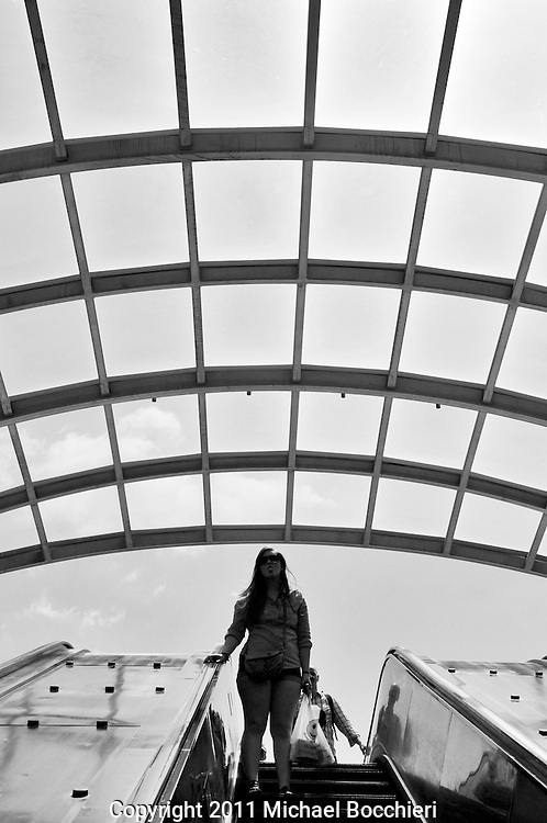 WASHINGTON, DC - May 21:  A woman rides the escalator of the Washington Metro at the Eastern Market station on May 21, 2011 in WASHINGTON, DC.  (Photo by Michael Bocchieri/Bocchieri Archive)