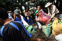 Coca pickers bring in their bags of freshly picked coca leaf to a lab for processing in a remote area of the southern Colombian state of Nariño, on Monday, June 25, 2007. Although government efforts to eradicate coca have reached many parts of Colombia, still the coca business thrives. (Photo/Scott Dalton)