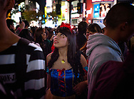 Young woman dressed as Snow White at Shibuya Crossing on Halloween night.  Tokyo, Japan