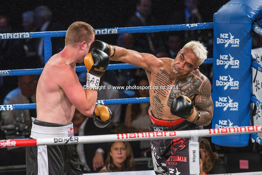 Monty Filimaea (R) fights James Emerson in the Mahindra Super 8 Fight Night, North Shore Events Centre, Auckland, New Zealand, Saturday, November 22, 2014. Photo: David Rowland/Photosport