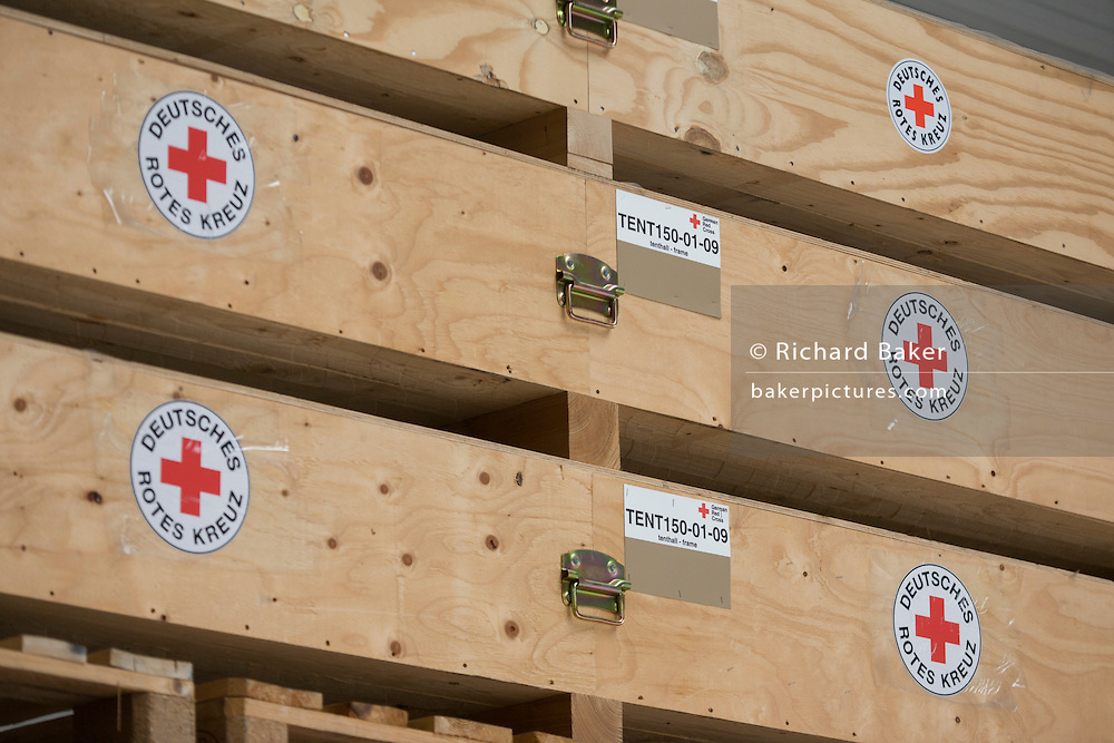 Frame tents in emergency supplies warehouse, Deutsches Rotes Kreuz (DRK - German Red Cross) at their logistics centre at Berlin-Schönefeld airport.