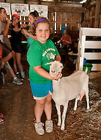 "Staci Cook and ""Avatar"" a short eared LaMancha dairy goat prepare for the 4H Fair at the Belmont Fairgrounds on Friday evening.  (Karen Bobotas/for the Laconia Daily Sun)"