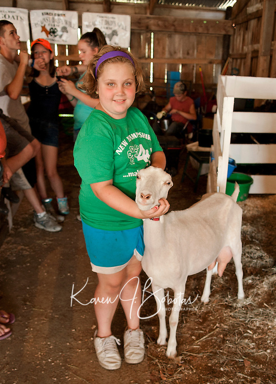 """Staci Cook and """"Avatar"""" a short eared LaMancha dairy goat prepare for the 4H Fair at the Belmont Fairgrounds on Friday evening.  (Karen Bobotas/for the Laconia Daily Sun)"""