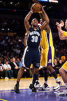 27 March 2007: Guard Dahntay Jones of the Memphis Grizzlies has his shot blocked by Lamar Odom of the Los Angeles Lakers during the first half of the Grizzlies 88-86 victory over the Lakers at the STAPLES Center in Los Angeles, CA.