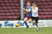 Jamie Ness of Scunthorpe United  and Alex Gilbey of colchester United cashe the ball  during the Sky Bet League 1 match between Scunthorpe United and Colchester United at Glanford Park, Scunthorpe, England on 23 January 2016. Photo by Ian Lyall.
