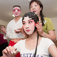 VENICE, ITALY - JULY 29:  A makeup artist prepares artist Luo Chenxue from the Kunqu Opera of Jiangsu ahead of the performance at Teatro Goldoni on July 29, 2011 in Venice, Italy. Kunqu Opera, now under the Unesco patronage, originated in the Jiangsu province, dating back to the early Ming dinasty. With a history of more than six hundred years, Kunqu Opera is a traditional type of Chinese drama and one of the most ancient opera forms in China and in the world.