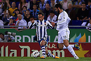 BARCELONA, SPAIN - MAY 11: (L) Sergio Garcia of RCD Espanyol  is followed by (R) Raul Albiol of Real Madrid CF during the Liga BBVA between RCD Espanyol and Real Madrid CF at the Cornella-El Prat Stadium on May 11, 2013 in Barcelona, Spain. (Photo by Aitor Alcalde Colomer).