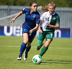 HAVERFORDWEST, WALES - Sunday, August 25, 2013: France's Aurelie Gagnet in action against Wales' Amy Wathan during the Group A match of the UEFA Women's Under-19 Championship Wales 2013 tournament at the Bridge Meadow Stadium. (Pic by David Rawcliffe/Propaganda)