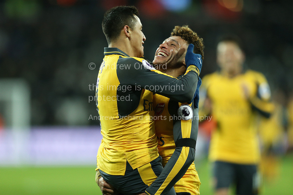 Alexis Sanchez of Arsenal (l) celebrates with Alex Oxlade-Chamberlain of Arsenal after scoring his sides 5th goal to make it 1-5. Premier league match, West Ham Utd v Arsenal at the London Stadium, Queen Elizabeth Olympic Park in London on Saturday 3rd December 2016.<br /> pic by John Patrick Fletcher, Andrew Orchard sports photography.