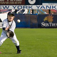 """Bryce Porter, of Costa Mesa, California fields a ball while waiting for the New York Yankee's Derek Jeter  during the Upper Deck, """"Play Ball! with Derek Jeter"""" clinic on Saturday, February 10, 2007 at Legends Field in Tampa, Florida.   Justin Topa, 15, of Binghampton, New York, Jordan Boone, 10, of Las Vegas, Nevada, Bryce Porter, 10, of Costa Mesa, California and Gavin Leonard, 9, of Bristol, Virginia, each won the grand prize to meet Jeter through various promotions on www.UpperDeckKids.com in 2006 .UPPER DECK/Scott Audette"""