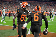Cleveland Browns rookie quarterback Baker Mayfield (6) celebrates with Cleveland Browns wide receiver Rashard Higgins (81) after Mayfield catches a third quarter pass for a successful two point conversion that ties the score at 14-14 during the 2018 NFL regular season week 3 football game against the New York Jets on Thursday, Sept. 20, 2018 in Cleveland. The Browns won the game 21-17. (©Paul Anthony Spinelli)