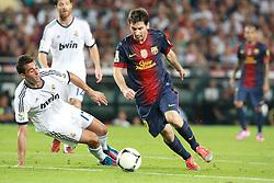 Lionel Messi attacks for Barcelona.  Barcelona v Real Madrid, Supercopa first leg, Camp Nou, Barcelona, 23rd August 2012...Credit - Eoin Mundow/Cleva Media.