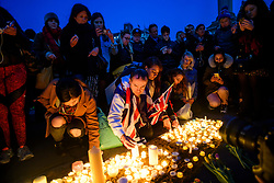 © Licensed to London News Pictures. 23/03/2017. London, UK. A vigil is held in Trafalgar Square, London, to remember those killed in the Westminster terror attack, the day after a lone terrorist killed 4 people and injured several more, in an attack using a car and a knife. The attacker managed to gain entry to the grounds of the Houses of Parliament, killing one police officer. Photo credit: Ben Cawthra/LNP
