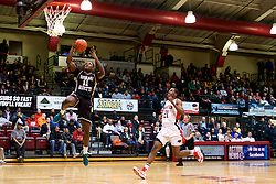 Forward Dymir Logan comes to late as Jamal Custis reaches for the hoop. (Bas Slabbers/for NewsWorks)