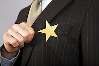 Businessman with gold star on suit close-up