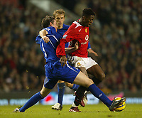 Photo: Aidan Ellis.<br /> Manchester United v Everton. The Barclays Premiership.<br /> 11/12/2005.<br /> United's Louis Saha cant find a way past Everton's David Weir