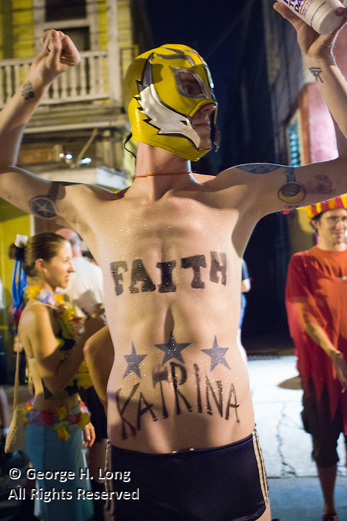 While many New Orleanians had already evacuated for Hurricane Katrina, this man prepared for the worst by attending the Mid-Summer Mardi Gras celebration with the Krewe of Oak outside the Maple Leaf Bar on Oak Street.  August 27, 2005