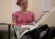 Copy editor Sarah McCoy, an Ohio University senior, checks the papers crossword puzzle during her late night Feb. 22.