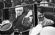President Hindenberg rides with Adoph Hitler after the latter's  appointment as Chancellor of Germany in January 1933.