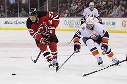 Mar 8; Newark, NJ, USA; New Jersey Devils right wing David Clarkson (23) skates with the puck while being defended by New York Islanders left wing Jay Pandolfo (29) during the first period at the Prudential Center.