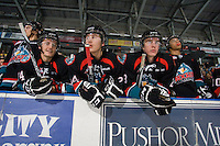 KELOWNA, CANADA, NOVEMBER 25: Cody Chikie #14, Tyson Baillie #24, Tanner Moar #23 and Tyrell Goulbourne #12 of the Kelowna Rockets stand on the bench as the Kootenay Ice visit the Kelowna Rockets  on November 25, 2011 at Prospera Place in Kelowna, British Columbia, Canada (Photo by Marissa Baecker/Shoot the Breeze) *** Local Caption *** Cody Chikie; Tyson Baillie; Tanner Moar, Tyrell Goulbourne;