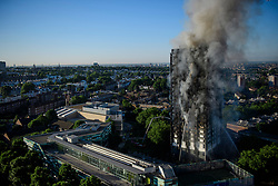 © Licensed to London News Pictures. 14/06/2017. London, UK. The scene of a huge fire at Grenfell tower block in White City, London. The blaze engulfed the 27-storey building with 200 firefighters attending the scene. There were reports of people trapped in the building. Photo credit: Ben Cawthra/LNP