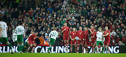 DUBLIN, IRELAND - Tuesday, February 8, 2011: Wales' wall (Andy King, Andrew Crofts, Freddie Eastwood, Simon Church, Danny Collins, Joe Ledley and James Collins) cannot prevent the Republic of Ireland's Keith Fahey from scoring the third goal from a free-kick during the opening Carling Nations Cup match at the Aviva Stadium (Lansdowne Road). (Photo by David Rawcliffe/Propaganda)