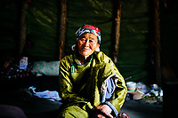 A portrait of an elder Tsaatan woman in the East Taiga of northern Mongolia. For generations, the Tsaatan peoples in this region have raised domesticated herds of reindeer for their livelihoods.