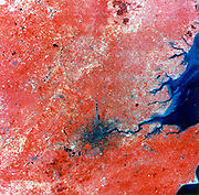 Composite photo of London taken by Landsat 2 from 905 km (560 miles). Green, red and infrared recorded separately, 11am 29 July 1975. NASA photograph.