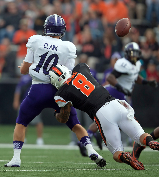 Weber State quarterback Jadrian Clark loses the ball after being hit by Oregon State's Rommel Mageo during the Beavers' 26-7 victory in the 2015 season opener in Reser Stadium, in Corvallis, on Friday, Sept. 4, 2015.