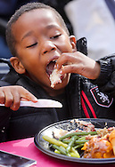 A boy enjoys his Thanksgiving meal on Wednesday November 25, 2015, in Los Angeles. Thousands of Skid Row residents and homeless people from downtown and beyond were served Thanksgiving dinners during the Los Angeles Mission's annual holiday feast. (Photo by Ringo Chiu/PHOTOFORMULA.com)<br /> <br /> Usage Notes: This content is intended for editorial use only. For other uses, additional clearances may be required.