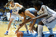 03 March 2013: North Carolina's Krista Gross (center) challenges for a loose ball with Duke's Elizabeth Williams (right) and Allison Vernerey (FRA) (43). The Duke University Blue Devils played the University of North Carolina Tar Heels at Cameron Indoor Stadium in Durham, North Carolina in a 2012-2013 NCAA Division I and Atlantic Coast Conference women's college basketball game. Duke won the game 65-58.